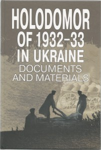 Holodomor of 1932-33 In Ukraine Documents and Matrials. This is the cover of the book, there are two indiviuals bacl and white in the distance placing bodies into graves.