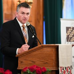 James Bezan, Member of Parliament, Selkirk–Interlake–Eastman, introducing Guest Speaker Dr. Norman Naimark during the commemorative dinner at the Fort Garry Hotel