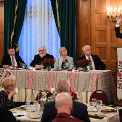 Head table with Dr. Norman Naimark speaking during the commemorative dinner at the Fort Garry Hotal