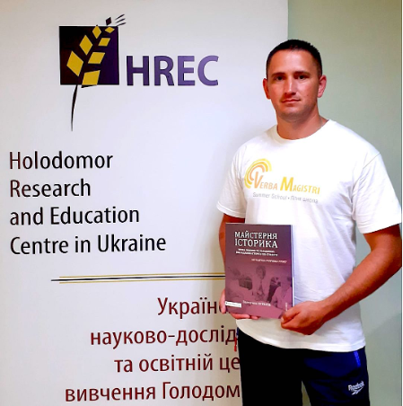 Teacher-participant Oleksiy Popovich (Chernivtsi, Ukraine) with Kuryliw's newly published book, The Historian's Craft.
