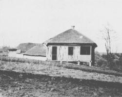 Taken in Kharkiv in 1932-33, this photograph is from the Innitzer Collection. It shows an abandoned house that has clearly had most of its worth stripped from it, probably by the secret police because the family were either arrested, deported, or had died of hunger in it.
