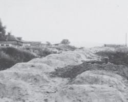 Taken in Kharkiv in 1932-33, this photograph is from the Innitzer Collection. It shows one of the mass grave sites used to bury the dead filled with victims of the Holodomor.