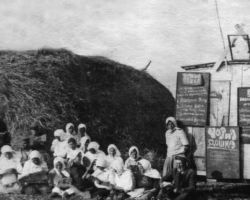 """Taken in Kyiv in 1932-33, this is a staged photograph of what was literally called a """"black board"""" or what we call being blacklisted. Because hiding food or supplies was a crime, the names of villagers who had been found with hidden grain or other food were listed on a black board. If officials found any food on an individual farm after the official grain collection had taken place, and if the quota was not met, the villager would be deemed an enemy of the state and the whole village punished."""