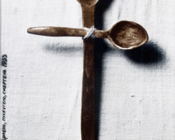 This is a photograph of two spoons placed on top of one another forming a cross, tied at the center with a thin hemp string, at the bottom of the image is embroidery, another Ukrainian cultural art form. This image is suppose to speak to the millions that died from hunger during the holodomor. By:Lekomtsev O-Morozovskiy